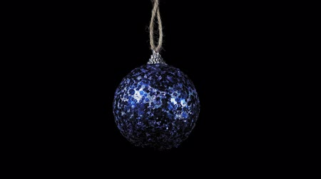 bombki : Blue ball rotates clockwise on black background, Christmas and New Year decoration isolated on dark, seamless looping.