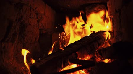 charred : A iron poker stir and prod dry firewood in fireplace. Stock Footage