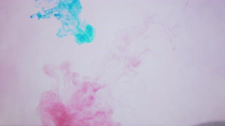 toner : Splashes of red and blue ink move in a fluid,toner forms intricate clouds and spots in water, abstract background.