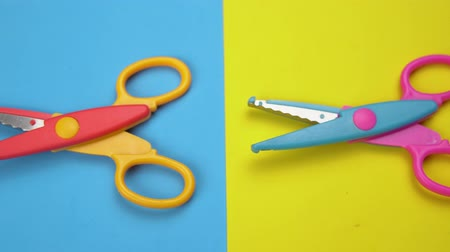 scrapbook : Set of a variety of wavy blade scissors for scrapbooking on colorful paper moves from left to right. Abstract minimal background with space for text.