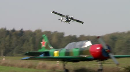 aerodrome : Aerodrome. Twin-engine plane lifted into air Stock Footage