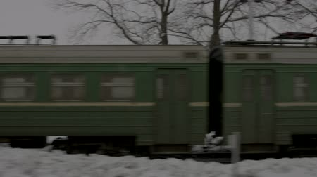 Image of train standing on tracks in winter Stock Footage