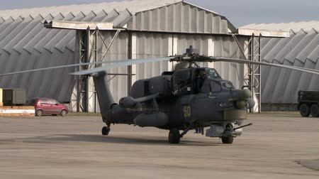 aerodrome : Military helicopter on background of hangars Stock Footage