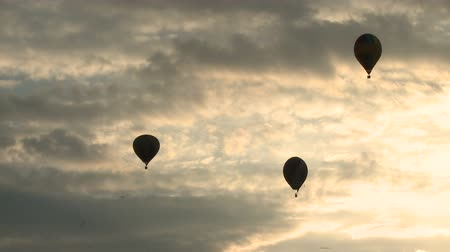 Silhouettes of air balloons in the evening sky Stock Footage