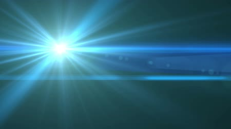 вспышка : Lens flare  light effect motion video. Abstract lens flare light over black background.Abstract blue digital lens flare background