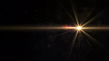 film camera : Digital lens flare in black background horizontal frame warm. Modern natural flare effect. Sunlight in space video Stock Footage
