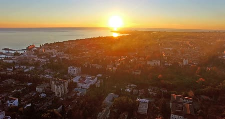 arrabaldes : aerial photography of the urban landscape with a beautiful sunset over the sea.