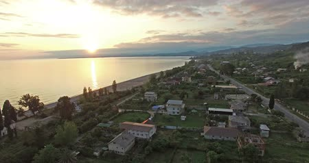 aerial photography of suburban landscape with a beautiful sunset over the sea.