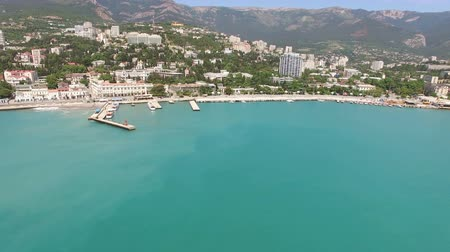Aerial survey of the resort of the Crimean city of Yalta in the summer from the sea Wideo