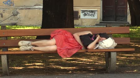 детеныш : Authentic emotion girl asleep on a bench in the park, the town of Olomouc, Europe EU