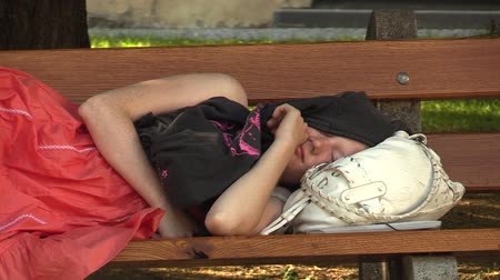 uykuda : Authentic emotion girl asleep on a bench in the park, the town of Olomouc, Europe EU