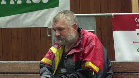 kryzys : Authentic emotion homeless man in the rain, town Brno, Europe