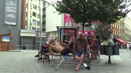 hobo : BRNO, CZECH REPUBLIC - SEPTEMBER 1, 2015: Authentic emotion homeless man senior asleep, awaking and eats canned, South Moravia, Europe, EU Stock Footage