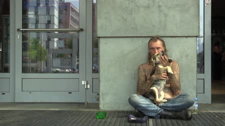 rescue dog : OLOMOUC, CZECH REPUBLIC - AUGUST 27, 2015: Authentic emotion senior homeless man begging in city with dog, town of Olomouc, Central Moravia, Czech Republic, Europe, EU Stock Footage