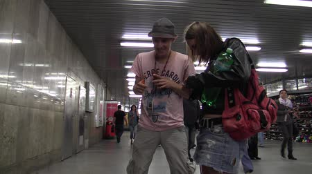 evsiz : BRNO, CZECH REPUBLIC - SEPTEMBER 10, 2015: Young homeless man begging in city, talking with friends, Receives money and people walking subway, South Moravia, Europe, EU Stok Video