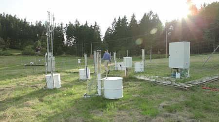 reseach : White Cross, CZECH REPUBLIC, SEPTEMBER 1, 2016: Scientist man in research, the research station for studying alpine meadows and mountains and the weather station, cycle and carbon flux, Europe