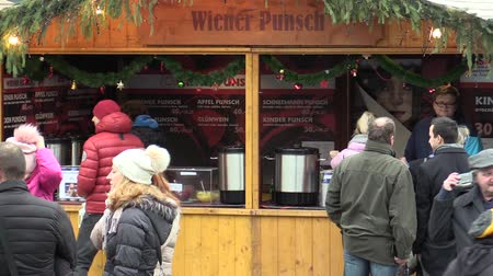 viennese : OLOMOUC, CZECH REPUBLIC, DECEMBER 24, 2017: Christmas markets stall booth with alcohol punch with fruit juice, people buy drinks in a cup and on a generous, wiener punsch