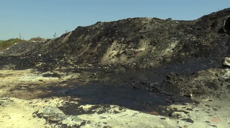 crude : The former dump toxic waste, effects nature from contaminated soil and water with chemicals and oil, environmental disaster, contamination of the environment