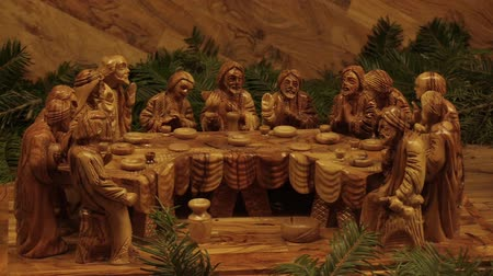 nailed to a cross : OLOMOUC, CZECH REPUBLIC, DECEMBER 17, 2017: The Last Supper of Jesus Christ, the day before his martyr, celebrated with his disciples the Easter celebration of Pesach. gospel dinner, hand carved wood