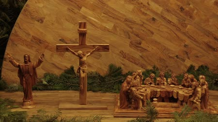nailed to a cross : OLOMOUC, CZECH REPUBLIC, DECEMBER 17, 2017: The Last Supper of Jesus Christ, the day before his martyr, celebrated with his disciples the Easter celebration, gospel dinner crucifixion, carved wood