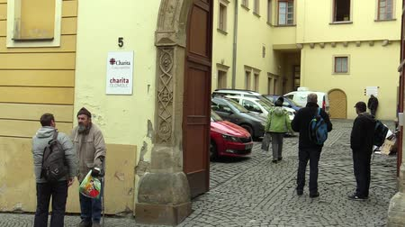 ghetto streets : OLOMOUC, CZECH REPUBLIC, JANUARY 3, 2018: The homeless charity center for the socially weak, the possibility of asylum to sleep overnight and the provided food and clothes Stock Footage