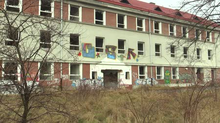 grafiti : OLOMOUC, CZECH REPUBLIC, JANUARY 18, 2018: The abandoned military building brownfield, where vandalism and grafitti spraying occurred. The object is a new manifestation of human vanity Wideo