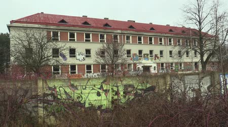 vandalismo : OLOMOUC, CZECH REPUBLIC, JANUARY 18, 2018: The abandoned military building brownfield, where vandalism and grafitti spraying occurred. The object is a new manifestation of human vanity Stock Footage