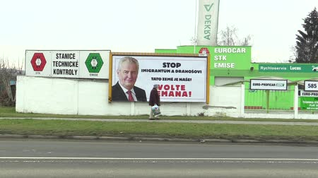 promocional : OLOMOUC, CZECH REPUBLIC, JANUARY 18, 2018: Billboard in support of the candidacy of Milos Zeman in direct election to the President of the Czech Republic in 2018, inscription: Stop Immigrants