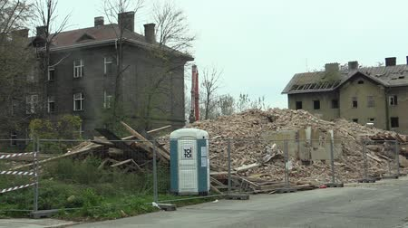 konzervált : PREROV, CZECH REPUBLIC, NOVEMBER 1, 2017: The house for the staff of the train station then the former Gypsy ghetto of Street in Prerov Demolition of a preserved historical building, people walk
