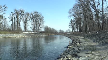 rock album : Regulated river Morava with flood protection measures large stones and concrete, increasing banks, building flood valleys and straightening the flow, contributing to the devastation of landscapes