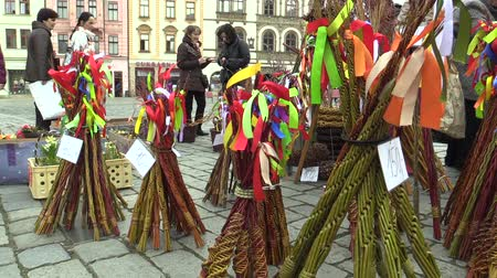 ostor : OLOMOUC, CZECH REPUBLIC, MARCH 30, 2018: Sales of traditional Easter whip folk celebrations holidays on the square market in Olomouc, holidays of spring and calm, Paschal holiday, people