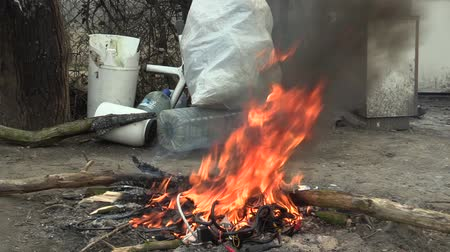 chloride : OLOMOUC, CZECH REPUBLIC, MARCH 20, 2018: The fire smoke of homeless, burning plastic electronic cables trash, air pollution and fire black, harmful substances phthalates, carbon monoxide carcinogenic
