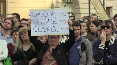 incapacidade : OLOMOUC, CZECH REPUBLIC, APRIL 9, 2018: Demonstration of people crowd against the Prime Minister Andrej Babis and president Milos Zeman, a banner with we want a decently Czech Republic