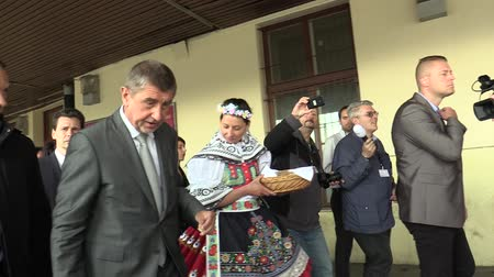 csehország : BRNO CZECH REPUBLIC, MAY 2, 2018: Prime Minister Andrej Babis arrived for the citizens of Brno, was welcomed by a woman in traditional folk costumes from southern Moravia go to the train station