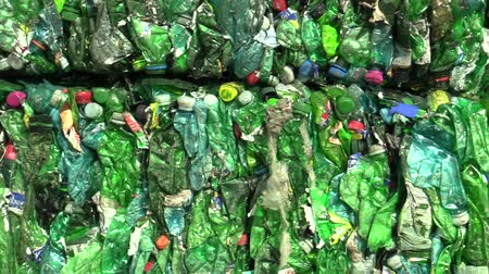 preslenmiş : OLOMOUC, CZECH REPUBLIC, APRIL 25, 2018: Separated and pressed green and transparent plastic bottles package ready for recycling and production of other new materials, environmentally