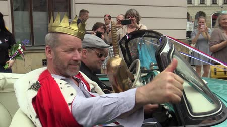 felicia : OLOMOUC CZECH REPUBLIC, MAY 9, 2018: King of months may David Koller students singer arrives in the 1960s historic car Skoda Felicia cabriotet. King golden crown, media journalists, photographers