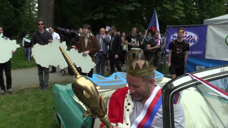 faculty : OLOMOUC CZECH REPUBLIC, MAY 9, 2018: King of months may David Koller singer arrives in the 1960s historic car of the Skoda Felicia cabriotet. King has a golden crown, a scepter and a cloak, students