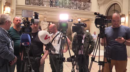 basın : BRNO CZECH REPUBLIC, MAY 2, 2018: Cameramen people and tripods before a press conference prime minister Andrej Babis arrived for the people of Brno, professional cameras and microphones