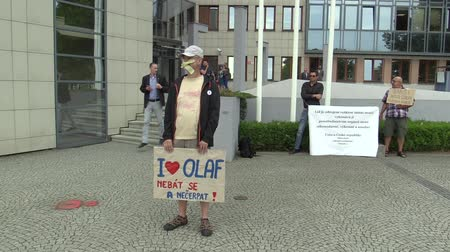 investigação : OLOMOUC, CZECH REPUBLIC, MAY 15 , 2018: Demonstration of people against the Prime Minister Andrej Babis a banner with the I love OLAF, not to be afraid or to use it, European Anti Fraud Office