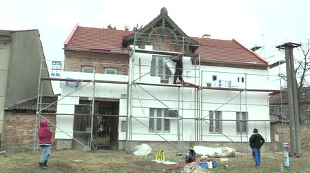 neutrality : OLOMOUC, CZECH REPUBLIC, APRIL 12, 2018: Thermal insulation carried out by workers in a family house villa use slab insulation boards with low water absorption and high penetration resistance thermal