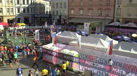 namesti : OLOMOUC, CZECH REPUBLIC, JUNE 23 , 2018: Half Marathon race run Olomouc 9th, track in center of city in square Horni namesti aerial shot, family run with children and baby carriages, happy runners