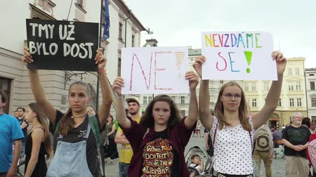 bastante : OLOMOUC, CZECH REPUBLIC, MAY 15 , 2018: Demonstration of people crowd against the Prime Minister Andrej Babis and president Milos Zeman, a banner with the darkness was enough, no, we will not give up