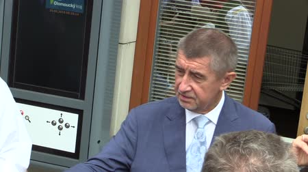 comes : OLOMOUC, CZECH REPUBLIC, MAY 15 , 2018: Czech Prime Minister Andrej Babis comes in Olomouc Region, man and woman in traditional Hana costume, welcomed bread with salt and alcohol plum liquor slivovitz