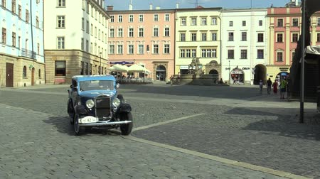 their : OLOMOUC, CZECH REPUBLIC, JULY 5, 2018: Historic car veteran on a public car ride through city of Olomouc drive people, first arriving of Praga Piccolo 1932, Czechoslovak interwar small car