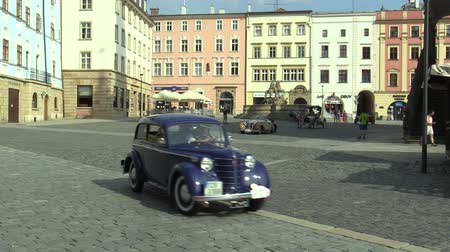their : OLOMOUC, CZECH REPUBLIC, JULY 5, 2018: Historic cars veterans on a public car ride through city of Olomouc drive people, first arriving of Opel Olympia 1939, Aero 30 1939, 1908 Buick Model 10 Stock Footage