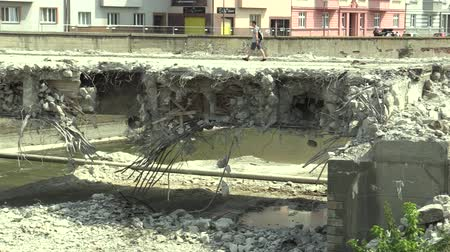 demolition : OLOMOUC, CZECH REPUBLIC, JULY 20, 2018: Demolition of a concrete and iron steel old bridge which people man and woman walking, entrance forbidden and do not enter, danger of accident and penalties