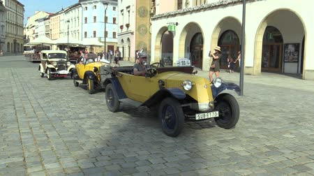 their : OLOMOUC, CZECH REPUBLIC, JULY 5, 2018: Historic cars veterans on a public car ride through city of Olomouc drive people, first arriving of Tatra 11 1923, Zbrojovka Brno Z 18 valnik and Walter Junior
