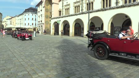 their : OLOMOUC, CZECH REPUBLIC, JULY 5, 2018: Historic cars veterans on a public car ride through city of Olomouc drive people, first arriving of Senechal SS 1924 and Ford T Touring 1912 Stock Footage