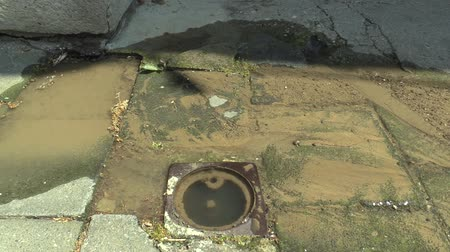 klín : Accidents escaping and draining water from the water pipe flowing down the sidewalk of the village, cracked armature soft wedge gate valve witch open indicator, Czech Republic, Europe Dostupné videozáznamy