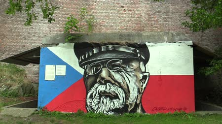 Československo : OLOMOUC, CZECH REPUBLIC, JULY 5, 2018: Graffiti graphics of Tomas Garrigue Masaryk face and cap and glasses at the concrete entrance to the antinuclear, spray paint
